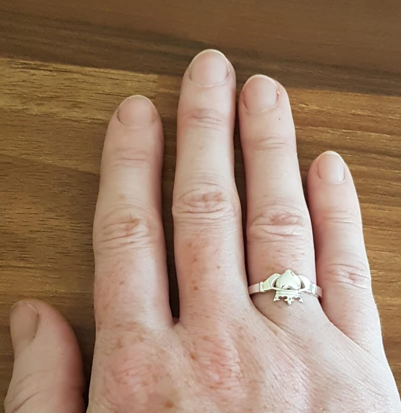 Wearing claddagh ring on left hand